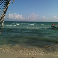 Photo taken at The Blue Parrot Beach Club by Fabiola A. on 12/28/2012