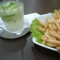 Photo taken at Violeta Bar & Restaurante by Thi Z. on 12/21/2012