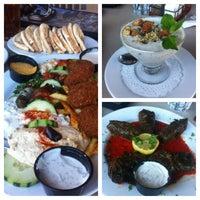 Photo taken at Paymon's Mediterranean Cafe & Hookah Lounge by Jason P. on 5/18/2013
