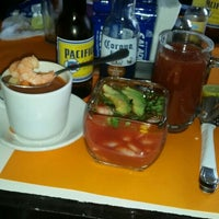 Photo taken at Mariscos Coral by DEn O. on 10/21/2015