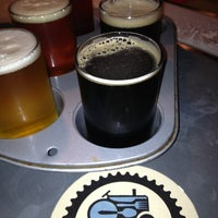 Photo taken at Blue Tractor BBQ & Brewery by Jenn R. on 7/28/2013
