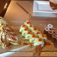 Photo taken at Bento Box Sushi Bar & Asian Kitchen by Jenee G. on 10/10/2012