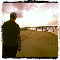 Photo taken at Oak Island Pier by Brian S. on 8/6/2012