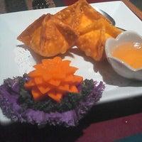 Photo taken at Thai Basil Restaurant by Joseph D. on 12/27/2012