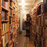 Photo taken at East Village Books by Spotted by Locals - city guides by locals on 8/9/2015
