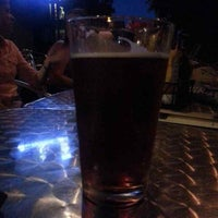 Photo taken at Tilted Kilt Pub & Eatery by Neil F. on 8/18/2013
