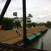 Photo taken at Taling Chan Floating Market by Jay J. on 8/18/2013