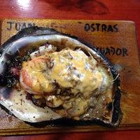 Photo taken at Juan Ostras by Raul B. on 12/22/2013