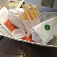 Photo taken at MOS Burger by Daphne L. on 12/23/2012