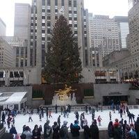 Photo taken at Rockefeller Center Christmas Tree by Asha I. on 12/25/2012