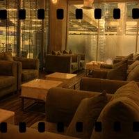 Photo taken at Louis' Tavern CIP Lounge by Bo L. on 12/25/2012
