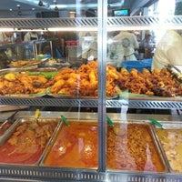 Photo taken at Original Kayu Nasi Kandar Restaurant by Azylia A. on 2/12/2013