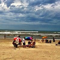 Photo taken at Praia de Imbé by Patricia S. on 3/3/2013