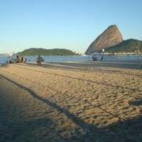 Photo taken at Praia do Flamengo by Hugo B. on 1/5/2013