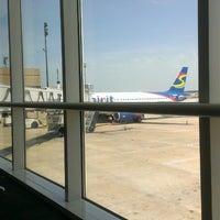 Photo taken at Gate A25 by Errol B. on 6/28/2013