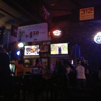 Photo taken at Bushwood Sports Bar & Grill by Tara B. on 12/31/2012
