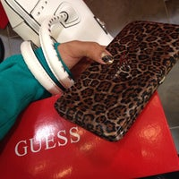 Photo taken at Guess by Hilda Y. on 12/19/2013