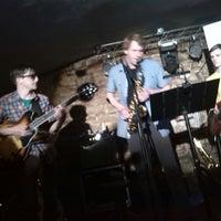 Photo taken at PopoCafePetl Café/Bar by Adam B. on 3/17/2014