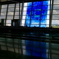 Photo taken at Concourse A by Aaron B. on 7/14/2013