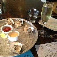 Photo taken at Skool Restaurant by Ryan B. on 3/31/2013
