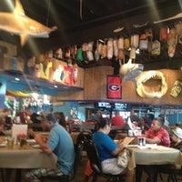 Photo taken at Iguanas Seafood Restaurant by Cassie U. on 8/10/2013
