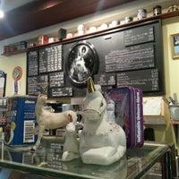 Photo taken at Unicorn Café by Veronica D. on 7/3/2013