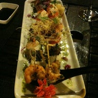 Photo taken at Lotus Japanese Fusion Cuisine by Rejane D. on 1/14/2013