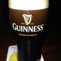 Photo taken at Fadó Irish Pub & Restaurant by Wendy F. on 6/1/2013