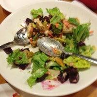 Photo taken at California Pizza Kitchen by Maxi B. on 1/12/2013