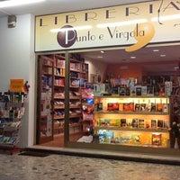 Photo taken at Libreria Punto E Virgola by Massimo P. on 3/8/2013