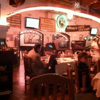 Photo taken at Carlos' n Charlie's by Mishael S. on 1/12/2013