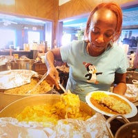 Photo taken at Nubian Queen Lola Cajun by Austin Chronicle on 6/18/2013