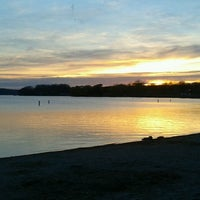Photo taken at Pewaukee Beach by Sam M. on 5/6/2013