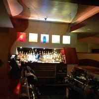 Photo taken at Eros Restaurant & Bar by Christine W. on 11/9/2012