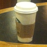 Photo taken at Starbucks by Claudia R. on 2/1/2013