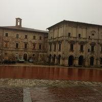 Photo taken at Piazza Grande by Rosangela N. on 3/26/2013