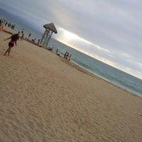 Photo taken at Playa de los Muertos by Ese E. on 2/24/2013