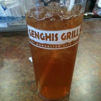 Photo taken at Genghis Grill by Amy H. on 2/16/2013