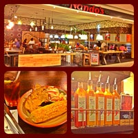 Photo taken at Nando's by Christian on 4/3/2013