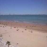 Photo taken at Playa de Valdelagrana by Pablo M. on 7/29/2013