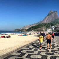 Photo taken at Praia de Ipanema by Eduardo S. on 6/4/2013