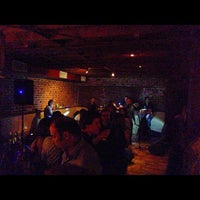 Photo taken at Cigar Bar & Grill by Dio V. on 10/6/2012