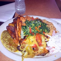 Photo taken at Trinity African Bar & Grill by Ike U. on 5/9/2014