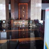 Photo taken at Gumaya Tower Hotel by Heru K. on 2/26/2013
