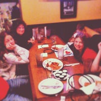 Photo taken at Oggi's Pizza & Brewing Company by Chris M. on 11/27/2013