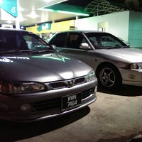 Photo taken at Petronas by Midiey on 7/25/2013