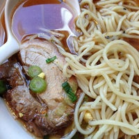 Photo taken at Ajisen Ramen by Andee Y. on 12/26/2012