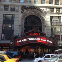 Photo taken at Hard Rock Cafe New York by Dogus Y. on 4/5/2013