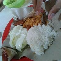 Photo taken at Ayam Goreng Tulang Lunak Bengawan by Alex E. on 6/11/2013