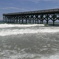Photo taken at Wrightsville Beach by alberto g. on 8/10/2013